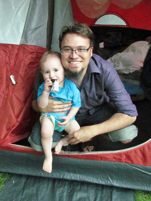 dad and boy in tent while camping
