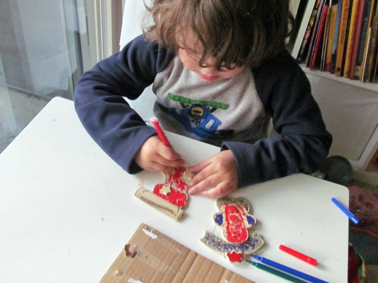 boy working with markers on ornament — holidays Christmas12