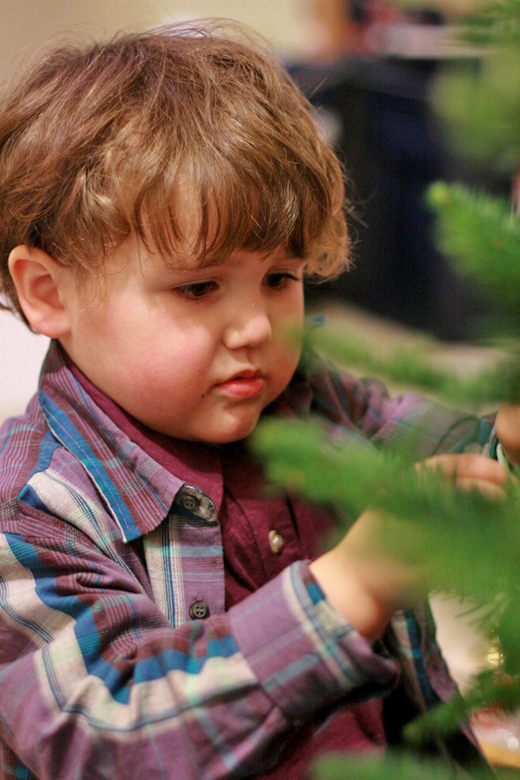 boy decorating Christmas tree in Fuerte polo shirt and Fiesta plaid shirt — Tea Collection giveaway