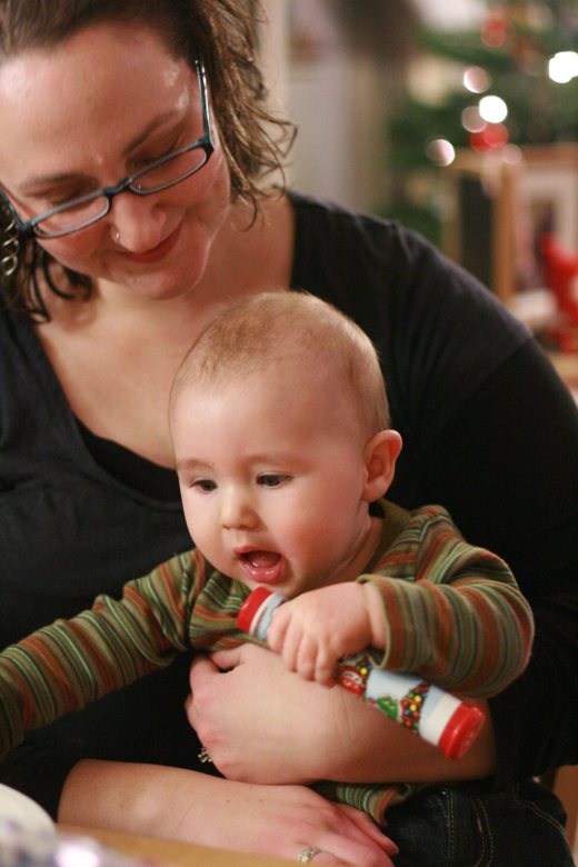 mom and baby at cookie decorating party — Christmas 2011
