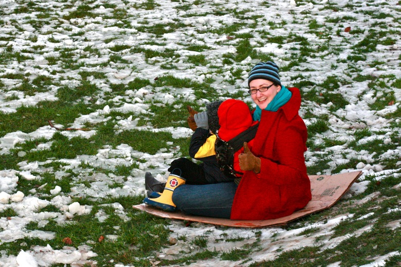 mom and kids sledding in winter outdoors in Seattle