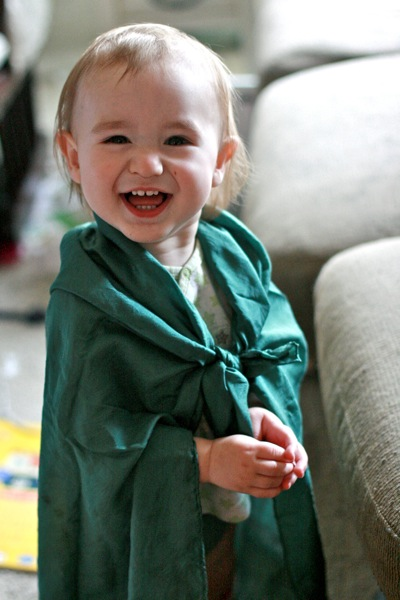 happy baby in playsilks cape