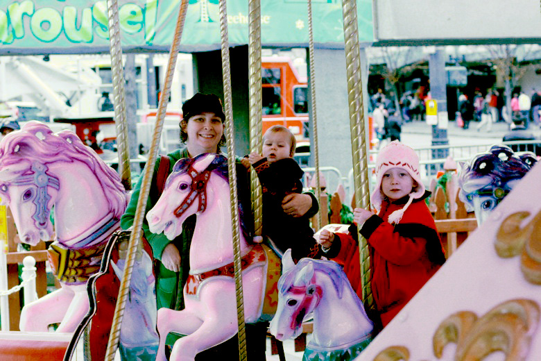 family on carousel — Christmas downtown Seattle meetup holidays