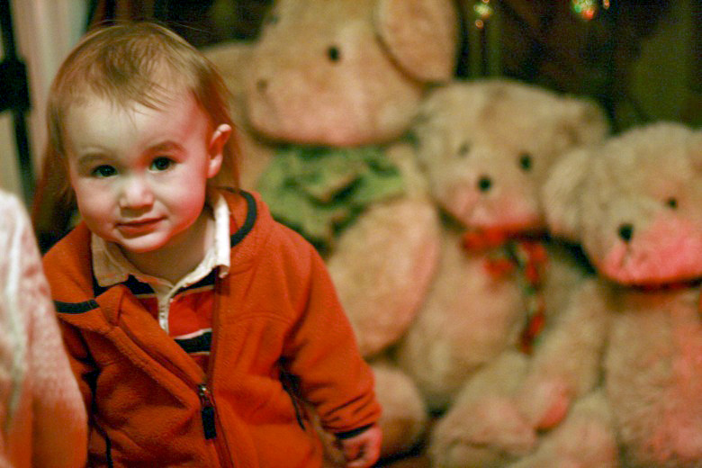 toddler in front of teddy bears — Christmas downtown Seattle meetup holidays