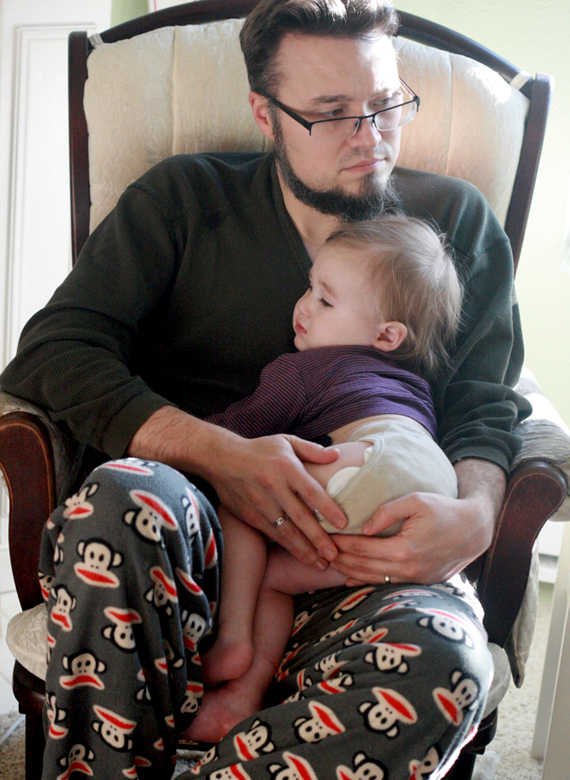 sick toddler snuggling with dad