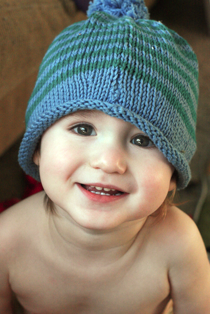 toddler boy in knit stripe hat smiling cute happy