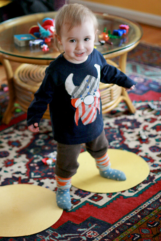 toddler boy in viking shirt on dot placemats - portland trip travel