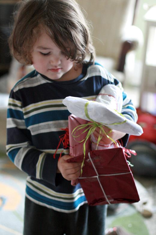 blase boy holding gifts - valentine's day 2013