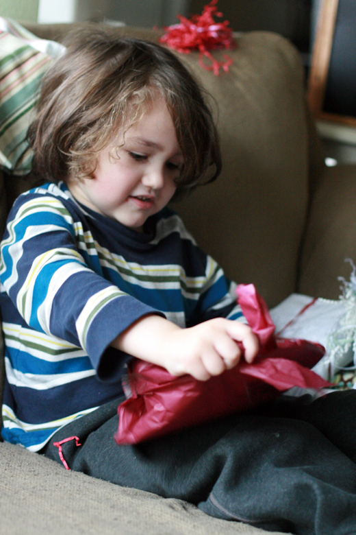 boy tearing into present - valentine's day 2013