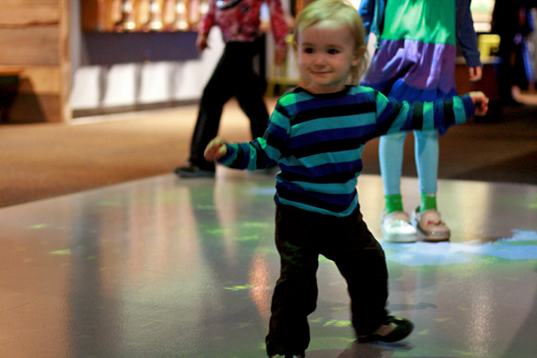 toddler busting moves on dance floor - pacific science center outing seattle unschooling