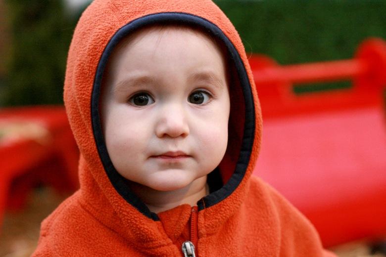 baby in orange hood