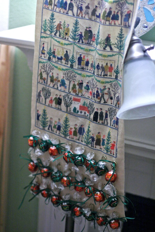 Advent calendar cross-stitched by nana and hung with candies