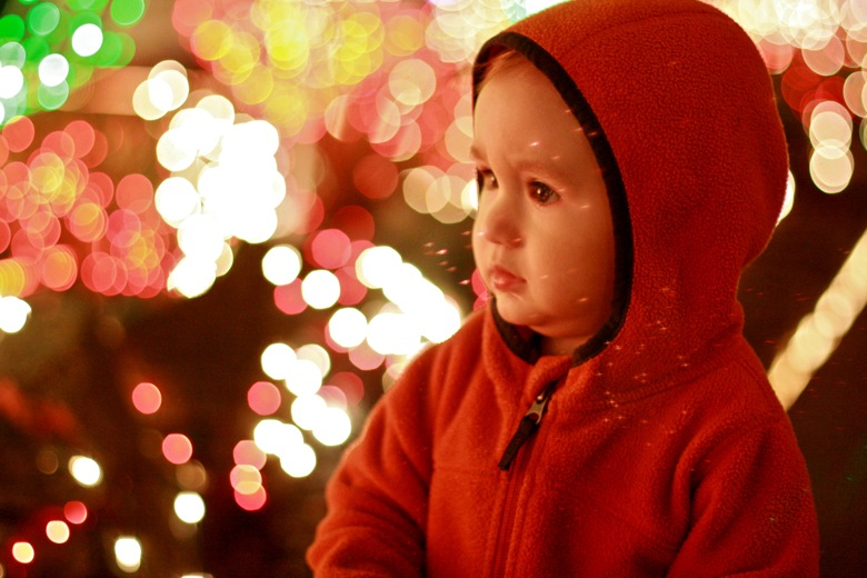 baby looking at Menashe Christmas lights
