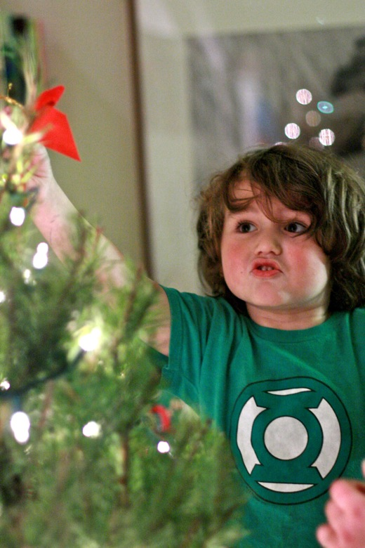 boy putting star on the top of the tree — christmas12 holidays mikko m5yo