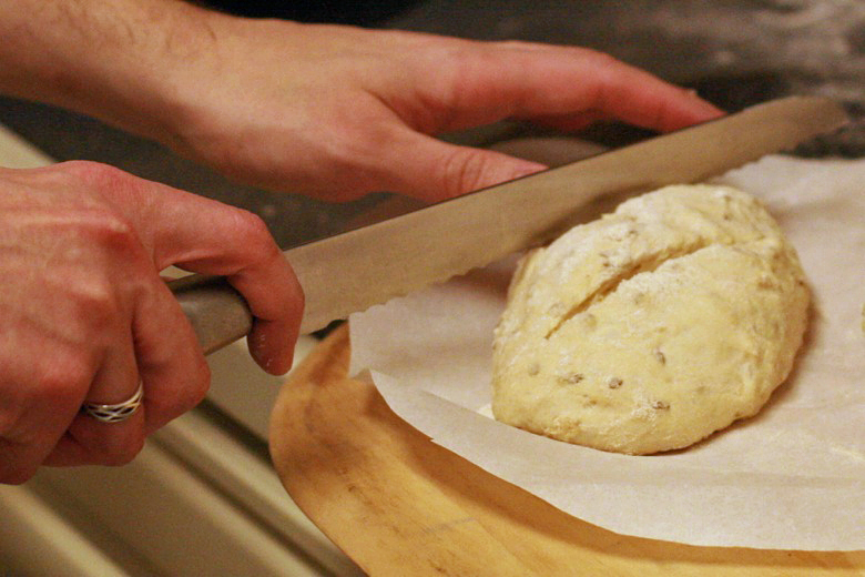slicing slits in dough loaves with serrated knife - cooking homemade easy bread recipe