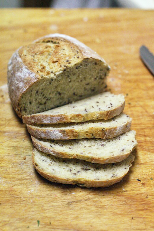 sliced baked loaf of bread with whole grains oats and flaxseed - cooking homemade easy bread recipe