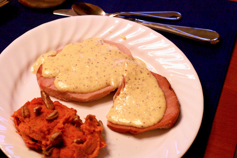 Easter dinner of ham with deviled egg sauce and mashed sweet potatoes