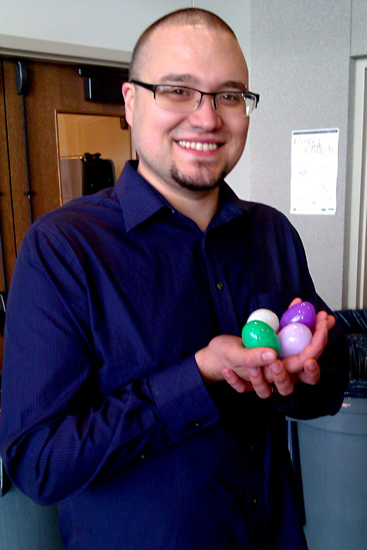 dad holding eggs in hand basket