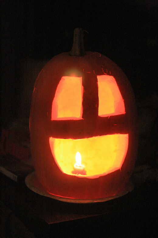 happy pumpkin jack-o'-lantern lit