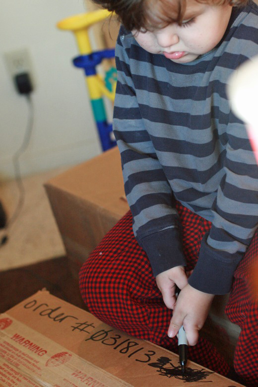 family business —  mikko m3yo marking out words on shipping box