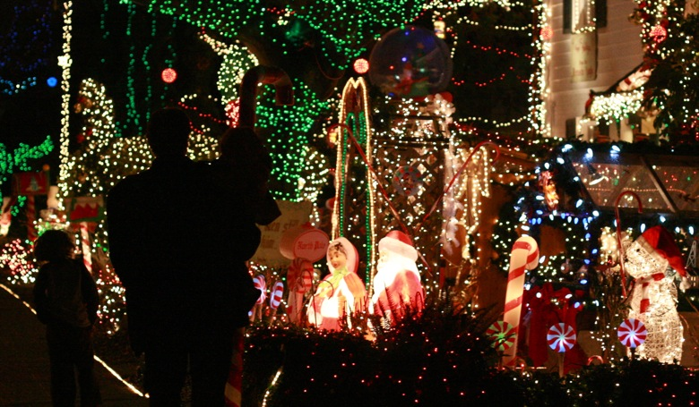 family silhouettes — Menashe Christmas lights West Seattle