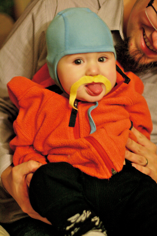 baby in mustache sticking out tongue