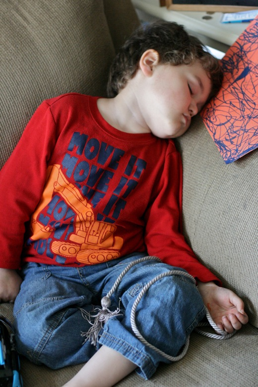 preschooler boy napping on the couch sitting up