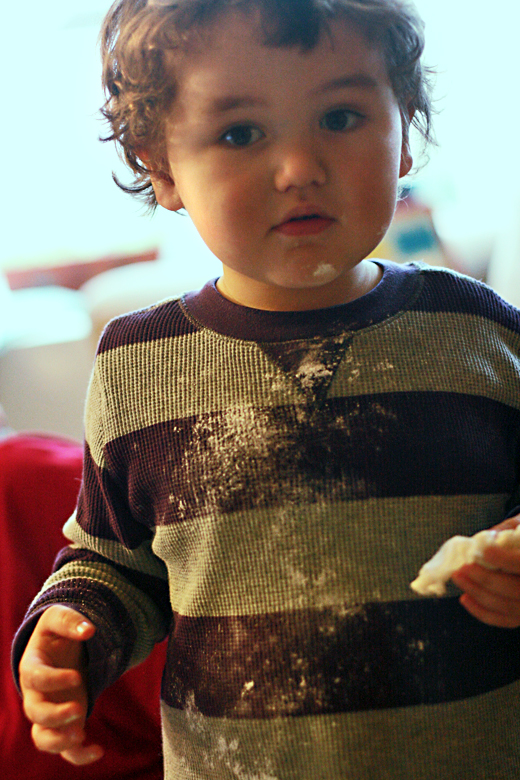 boy with powdered sugar all down his shirt