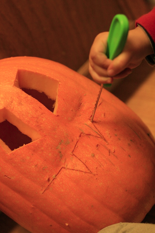 carving the pumpkin smile