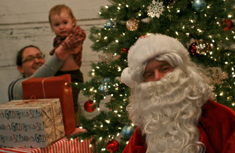 baby popping up — visiting Santa for pictures