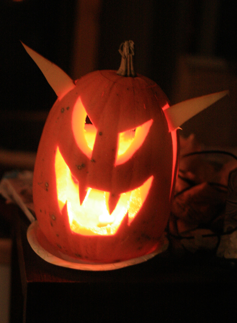 scary jack-o'-lantern lit
