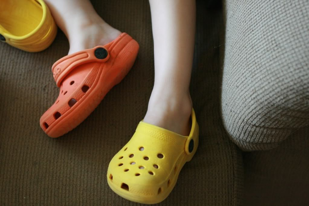 two different colored crocs on toddler